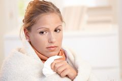 Portrait of young female having flu feeling bad Stock Images