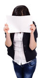 Portrait of  young female hiding behind papers Stock Photography