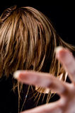Portrait of young female hiding her face with hair Royalty Free Stock Photography