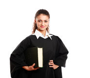 Portrait of a young female judge, isolated on. Portrait of a young female judge with law book, isolated on white background Stock Images