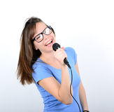 Portrait of a young female with microphone against white backgro Royalty Free Stock Photos