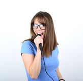 Portrait of a young female with microphone against white backgro Stock Photos