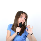 Portrait of a young female with microphone against white backgro Stock Images