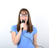 Portrait of a young female with microphone against white backgro Stock Photography
