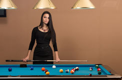 Portrait Of A Young Female Model Playing Billiards Stock Images