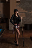 Portrait Of A Young Female Model Playing Billiards Royalty Free Stock Photo