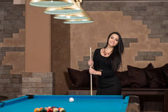 Portrait Of A Young Female Model Playing Billiards Royalty Free Stock Images