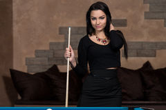 Portrait Of A Young Female Model Playing Billiards Stock Image