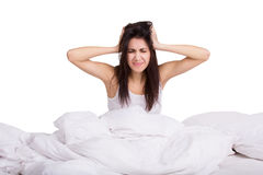 Portrait of young female in the morning with alarm clock. Woman does not want to wake up. Isolated Stock Images