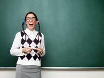 Portrait of young female nerd Stock Photos