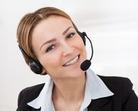 Portrait of young female operator Stock Photography