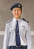 Portrait of young female police officer, Beijing, China. BEIJING-SEPTEMBER 28, 2012. Young female Police officer. Chinese cities are looking to improve their Royalty Free Stock Photography