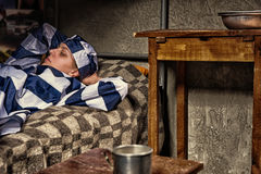 Portrait of young female prisoner wearing prison uniform has los Royalty Free Stock Images