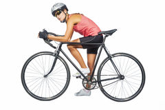 Portrait of young female professional cycling athlete posing wit Stock Photos
