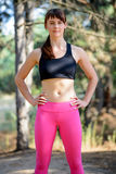 Portrait of Young Female Runner in Beautiful Wild Pine Forest. Active Lifestyle Concept. Royalty Free Stock Photo