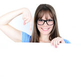 Portrait of a young female showing empty space ay blank board Royalty Free Stock Photos