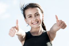 Portrait of young female showing a thumbs up Stock Photo