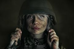 Portrait of young female soldier stock photography
