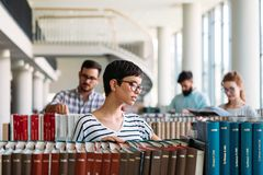 Portrait of young female student in library. Portrait of young female student in university library Stock Photos