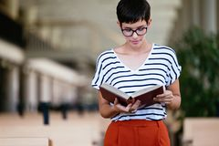 Portrait of young female student in library. Portrait of young female student in university library Stock Image