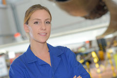 Portrait young female worker in blue jacket Stock Photo