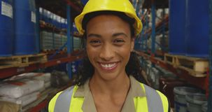 Portrait of young female worker in a warehouse stock video