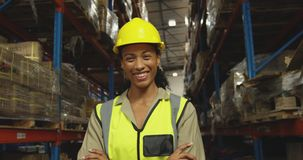Portrait of young female worker in a warehouse stock video footage