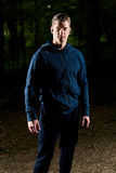 Portrait of a young fit athlete in sportswear in the forest to n Royalty Free Stock Images