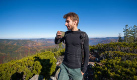Portrait of young fit male hiker drinking tea royalty free stock photo