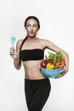 Portrait of young fit woman eating vegetables Stock Image
