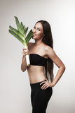 Portrait of young fit woman holding leek Royalty Free Stock Photography