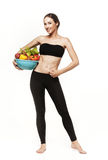 Portrait of young fit woman holding vegetables Royalty Free Stock Photos