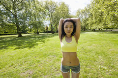 Portrait of young fit woman stretching at park Stock Images