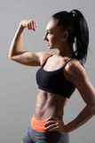 Portrait of young fitness woman shows biceps Stock Image