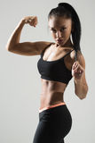 Portrait of young fitness woman shows biceps Stock Photography