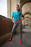 Portrait of young fitness woman standing close to Ponte Vecchio Stock Image
