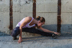 Portrait of a young fitness woman stretching outdoors Royalty Free Stock Photography