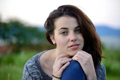 Portrait of a young freckled young woman with mountain background Stock Image