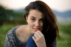 Portrait of a young freckled young woman with mountain background Royalty Free Stock Image