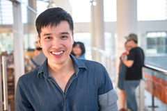 Portrait of a young and fresh asian boy in the campus Royalty Free Stock Photography