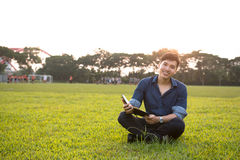 Portrait of a young and fresh asian boy in the campus Stock Photos