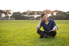 Portrait of a young and fresh asian boy in the campus Royalty Free Stock Photos