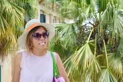 Portrait of young in front of palm trees Stock Image