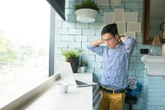 Portrait of young frustrated stressed business man in casual dre Stock Photo