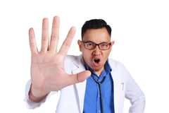Funny Doctor Showing Stop Sign stock image