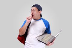 Young Asian Student Mocking Making Funny Face Royalty Free Stock Photos