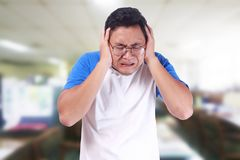 Young Man Closes Ears Afraid to Hear Something Bad Stock Photography