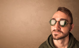 Portrait of a young funny man with sunglasses and copyspace royalty free stock image