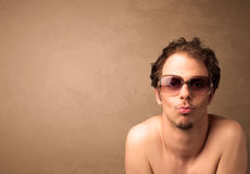 Portrait of a young funny man with sunglasses and copyspace Stock Photography