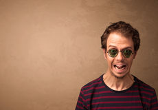 Portrait of a young funny man with sunglasses and copyspace Stock Photo